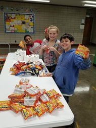 Ninth District students organizing donation bags