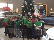 Students from Ninth District singing Christmas Carols at Lexus.