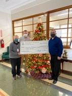Dr. Janice Wilkerson Accepts Donation from Gateway Lodge