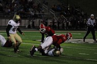 Mike Hall makes a tackle against Harrison County