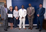 Covington employees receive award at the state Board of Education meeting.
