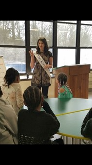 Miss Kentucky speaks with the girls at Ninth District