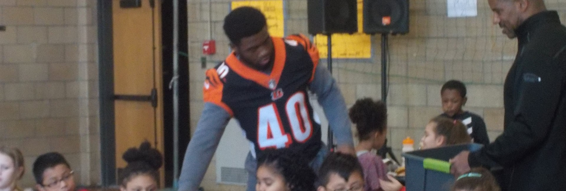 Cincinnati Bengal #40 Brandon Wilson enjoys lunch with students