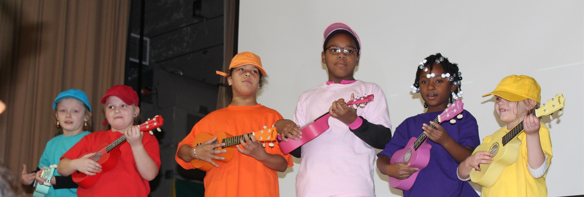Students at Sixth District use their musical talent to play the ukulele.