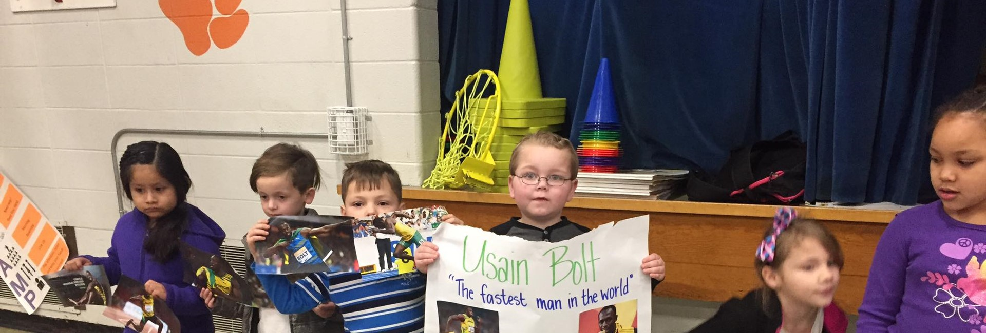 The first grade class of Ms. Hall does a presentation on Usain Bolt, Olympic sprinter, for Black History Month.