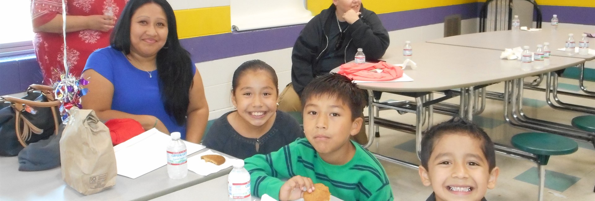 The De Dios Family enjoying cookies at Kindergarten Graduation